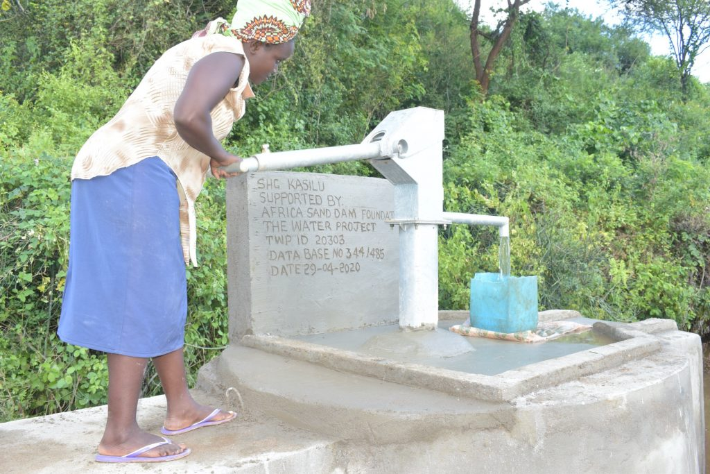The Water Project : kenya20303-pumping-the-completed-well