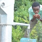 The Water Project: Nzimba Community A -  Drinking From The New Well