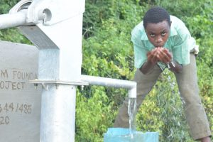 The Water Project:  Drinking From The New Well