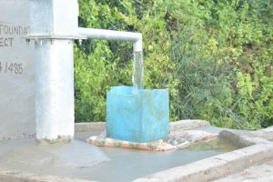 The Water Project:  Filling Up Container At The Well