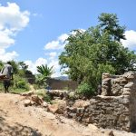 The Water Project: Nduumoni Community A -  Carrying Rocks For The Well