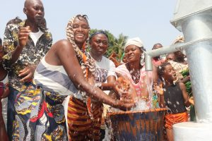The Water Project:  Community Women Celebrating And Splashing Water