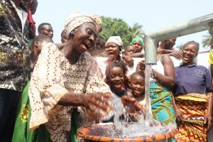 The Water Project:  Old Woman Celebrates At The Well