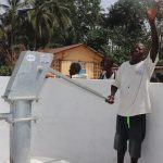 The Water Project: Lungi, Rosint, #26 Old Town Road -  Young Man Happy With The Well
