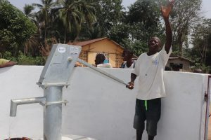 The Water Project:  Young Man Happy With The Well