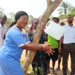 The Water Project: Lungi, Madina, St. Mary's Junior Secondary School -  School Principal Demonstrating Handwashing Method