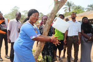 The Water Project:  School Principal Demonstrating Handwashing Method