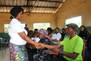 The Water Project:  Hygiene Facilitator Teaching How Disease Transfer Through Hand Shaking