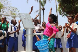 The Water Project:  School Teacher And Student Celebrating For Safe Drinking Water Provide Forthe At Their School