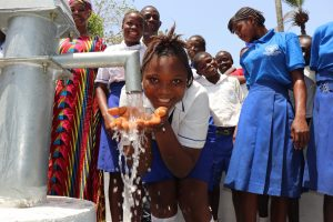 The Water Project:  Student Happy Drinking Water