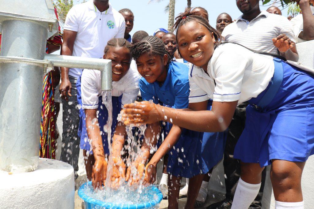 The Water Project : sierraleone20405-students-happy-splashing-water