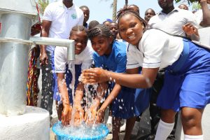 The Water Project:  Students Happy Splashing Water