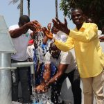 The Water Project: Lungi, Madina, St. Mary's Junior Secondary School -  Teachers Celebrating And Splashing Clean Safe Drinking Water