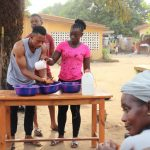 The Water Project: Lungi, Thomossoh, #24 Thullah Street -  Participant Demonstrating One Of The Handwashing Methods