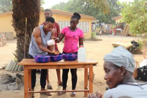 The Water Project:  Participant Demonstrating One Of The Handwashing Methods