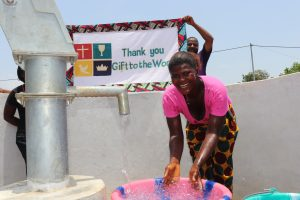 The Water Project:  Splashing Water With Banner