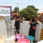 The Water Project: Lungi, Thomossoh, #24 Thullah Street -  Women Celebrating With The Banner