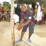 The Water Project: Lungi, Thomossoh, #24 Thullah Street -  Young Man Demonstrating Handwashing Method