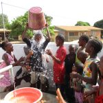 The Water Project: Lungi, Thomossoh, #24 Thullah Street -  Small Boy Dumps Water On Himself