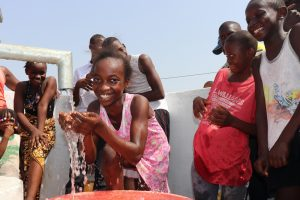 The Water Project:  Small Girl Drinks From The Well