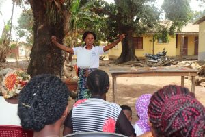 The Water Project:  Hygiene Facilitator Teaching About Tippy Tap