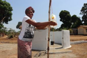 The Water Project:  Woman Washes Her Hands