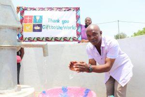 The Water Project:  Community Elder Splashing Water