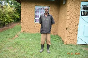 The Water Project:  Philip Omukiti Outside His Home