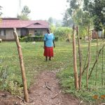 The Water Project: Ataku Community, Ngache Spring -  Catherine Waka At The Gate To Her Home