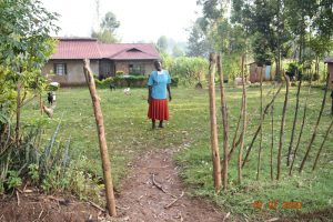 The Water Project:  Catherine Waka At The Gate To Her Home