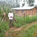 The Water Project: Emukoyani Community, Ombalasi Spring -  Niskson Sakwa Shivuka Outside His Homestead