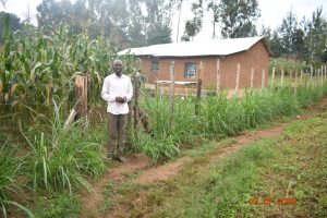 The Water Project:  Niskson Sakwa Shivuka Outside His Homestead