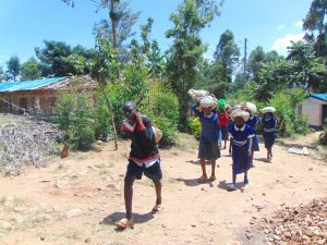 The Water Project:  Students Carrying Sand To Construction Site