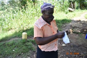 The Water Project:  Josephine Sews A Mask At Covid Training