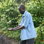 The Water Project: Munenga Community, Burudi Spring -  Silas Washes His Hands At The Spring