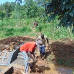 The Water Project: Ewamakhumbi Community, Mukungu Spring -  Backfilling With Clay