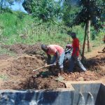 The Water Project: Ewamakhumbi Community, Mukungu Spring -  Backfilling With Soil