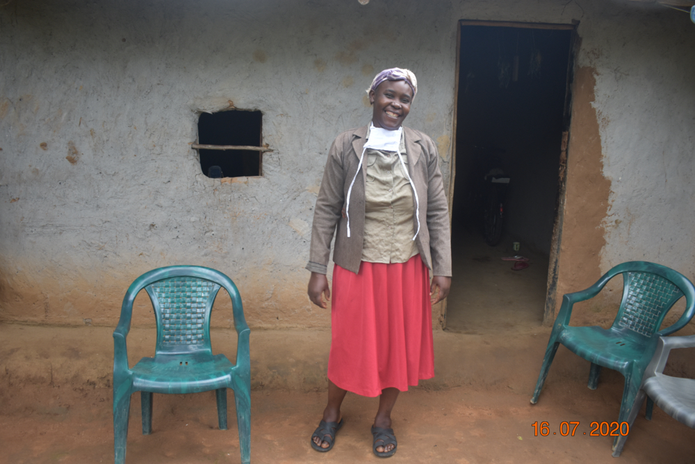 The Water Project : 2-covid19-kenya18312-josephine-shamala-outside-her-home-1
