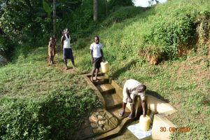 The Water Project:  Observing Social Distancing While Fetching Water