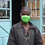 The Water Project: Mungakha Community, Asena Spring -  Philip Wears His Mask