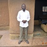 The Water Project: Emukoyani Community, Ombalasi Spring -  Niskson Sakwa Shivuka Outside His Home