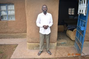 The Water Project:  Niskson Sakwa Shivuka Outside His Home