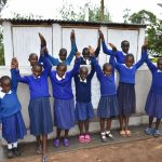 The Water Project: Mutiva Primary School -  Girls In Front Of Their Latrines