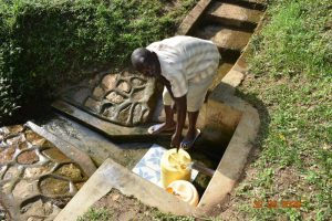 The Water Project:  Patrick Fetching Water From Nyanje Spring