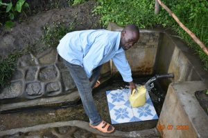 The Water Project:  Silas Fetches Water From Burudi Spring