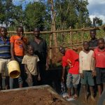 The Water Project: Ewamakhumbi Community, Mukungu Spring -  Boys And Men Pose With The Spring