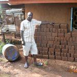 The Water Project: Mungakha Community, Nyanje Spring -  Patrick Makes Bricks Using Water From Nyanje Spring