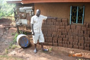 The Water Project:  Patrick Makes Bricks Using Water From Nyanje Spring