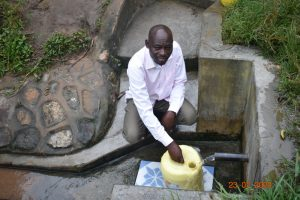 The Water Project:  Niskson Fetches Water At Ombalasi Spring
