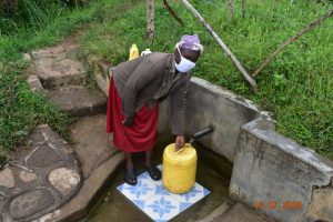 The Water Project:  Josephine Fetches Water From Indangasi Spring
